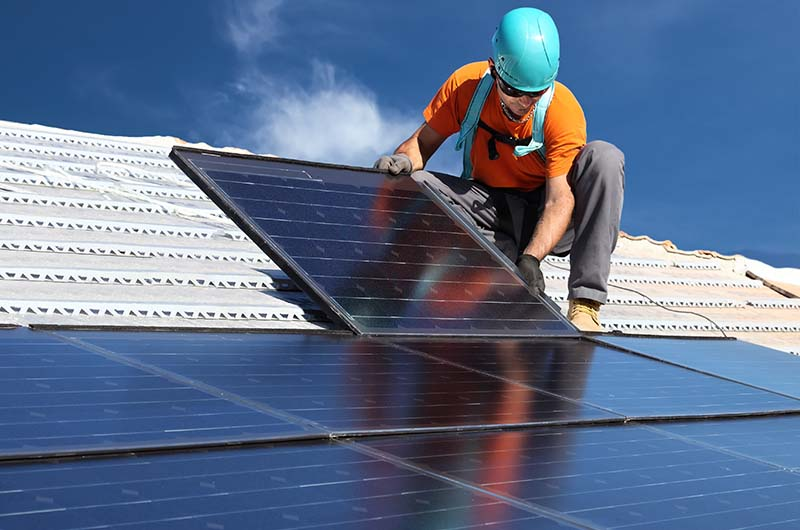 installing alternative energy photovoltaic solar panels on roof1_Web.jpg